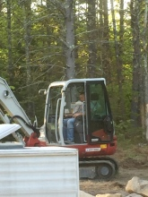 hubby wearing the ergo doing site work